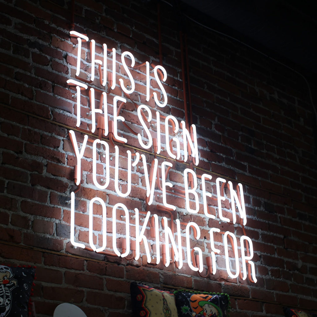 "neon sign that says ""this is the sign you've been looking for"""